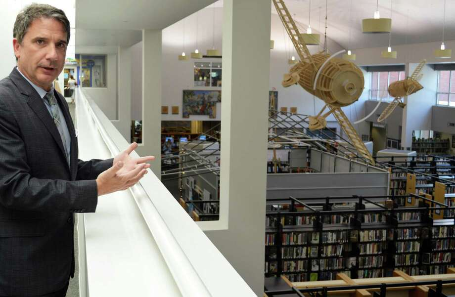 William Harmer, the Westport Library's new executive director, looks from the atrium over the MakerSpace and art area, which he said is a vibrant part of the library. Photo: Jarret Liotta / For Hearst Connecticut Media / Westport News