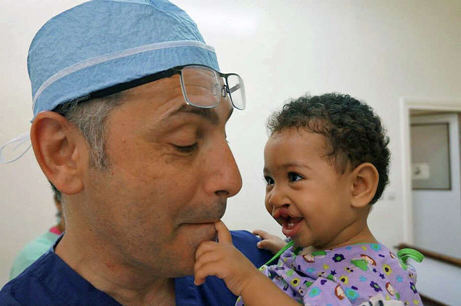 Dr. Alfred Sofer, a Fairfield plastic surgeon, and one of the young patients he treated while on a mission to Morocco with Operation Smile. Photo: Contributed Photo / Fairfield Citizen /  Fairfield Citizen contributed