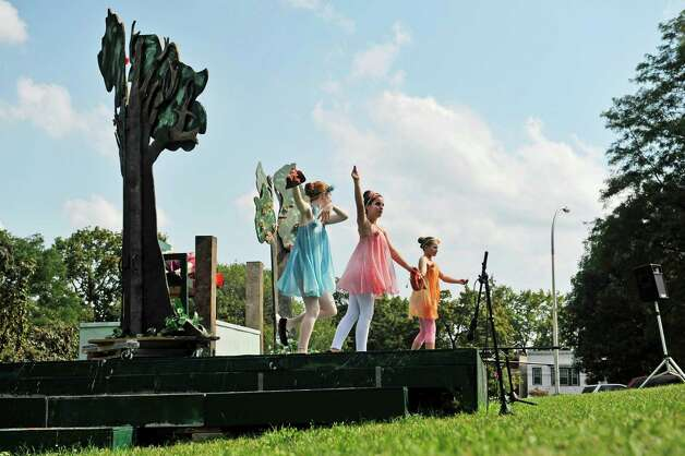 Kelly Nolan, left, Vivian Tidd, center, and Ingrid Colafati play the part of fairies during the Steamer No.10 Theatre's production of A Midsummer Night's Dream on the east lawn of the Sunshine School in Lincoln Park on Sunday, Aug. 16, 2015, in Albany, N.Y.  The production continues Aug. 21st. and 22nd at 7pm and Aug. 23rd at 3pm.  This is the second year of the theatre's AlbanyOs Shakespeare in Lincoln Park program.  (Paul Buckowski / Times Union) Photo: PAUL BUCKOWSKI / 00032944A