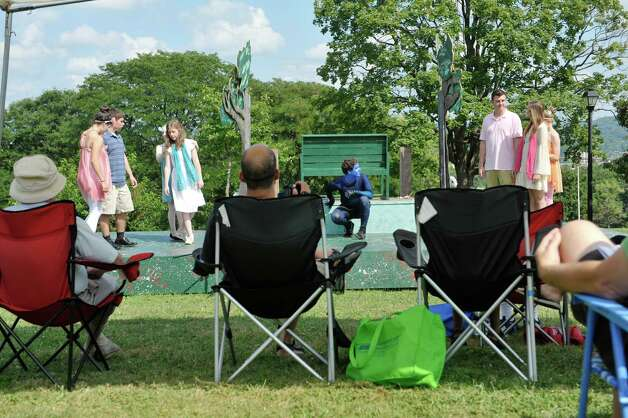 Actors perform on stage during the Steamer No.10 Theatre's production of A Midsummer Night's Dream on the east lawn of the Sunshine School in Lincoln Park on Sunday, Aug. 16, 2015, in Albany, N.Y.  The production continues Aug. 21st. and 22nd at 7pm and Aug. 23rd at 3pm.  This is the second year of the theatre's AlbanyOs Shakespeare in Lincoln Park program.  (Paul Buckowski / Times Union) Photo: PAUL BUCKOWSKI / 00032944A