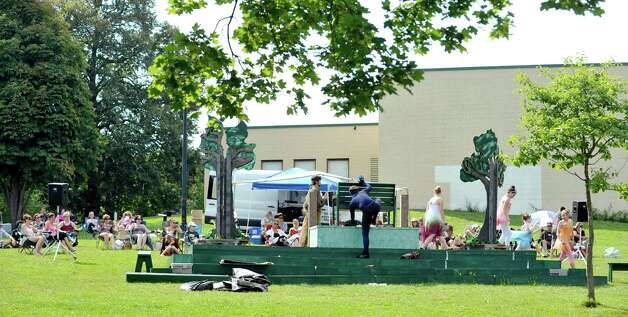 Actors run across the stage during the Steamer No.10 Theatre's production of A Midsummer Night's Dream on the east lawn of the Sunshine School in Lincoln Park on Sunday, Aug. 16, 2015, in Albany, N.Y.  The production continues Aug. 21st. and 22nd at 7pm and Aug. 23rd at 3pm.  This is the second year of the theatre's AlbanyOs Shakespeare in Lincoln Park program.  (Paul Buckowski / Times Union) Photo: PAUL BUCKOWSKI / 00032944A
