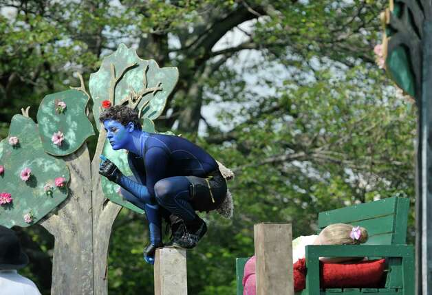 Alain Ackerman plays the part of Puck during the Steamer No.10 Theatre's production of A Midsummer Night's Dream on the east lawn of the Sunshine School in Lincoln Park on Sunday, Aug. 16, 2015, in Albany, N.Y.  The production continues Aug. 21st. and 22nd at 7pm and Aug. 23rd at 3pm.  This is the second year of the theatre's AlbanyOs Shakespeare in Lincoln Park program.  (Paul Buckowski / Times Union) Photo: PAUL BUCKOWSKI / 00032944A