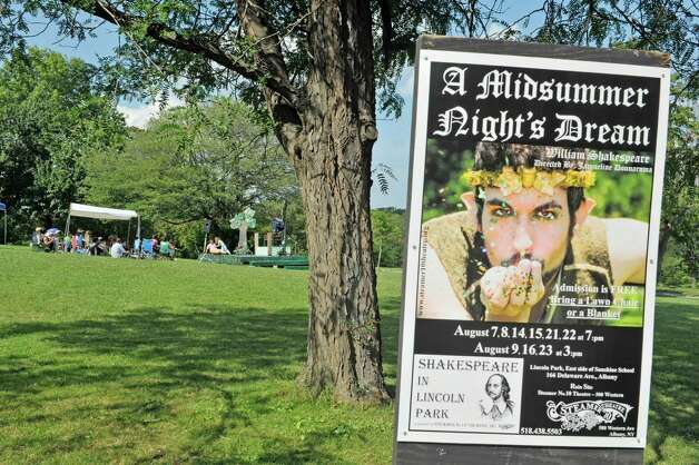A poster for the Steamer No.10 Theatre's production of A Midsummer Night's Dream is seen on display as actors perfrom on the east lawn of the Sunshine School in Lincoln Park on Sunday, Aug. 16, 2015, in Albany, N.Y.  The production continues Aug. 21st. and 22nd at 7pm and Aug. 23rd at 3pm.  This is the second year of the theatre's AlbanyOs Shakespeare in Lincoln Park program.  (Paul Buckowski / Times Union) Photo: PAUL BUCKOWSKI / 00032944A