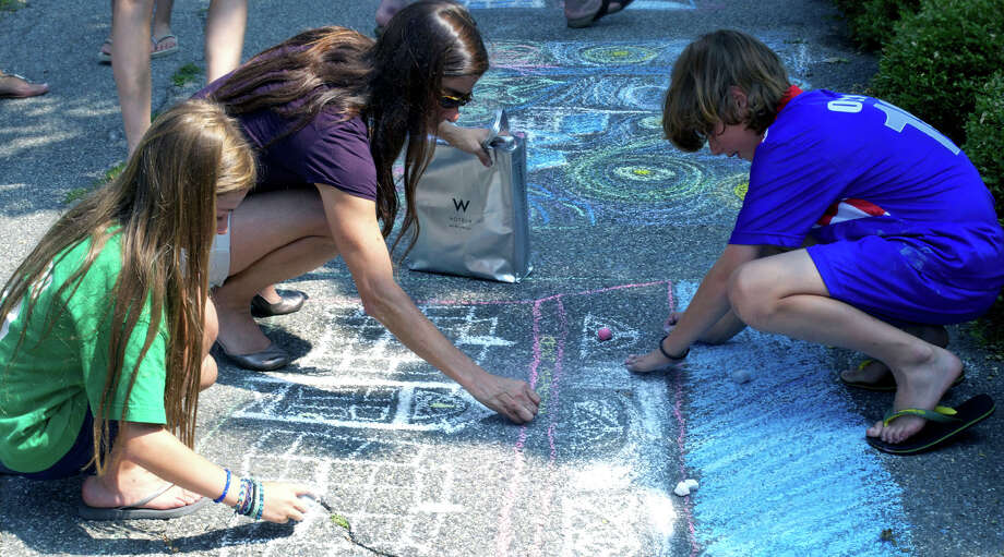 Chalk the Walks is a national project started by The Joy Team — it is a way to spread joy, optimism and inspiration. The idea is to write positive messages on your sidewalks, driveways and parking lots in plain old sidewalk chalk. Photo: File Photo / Connecticut Post / Trish Haldin