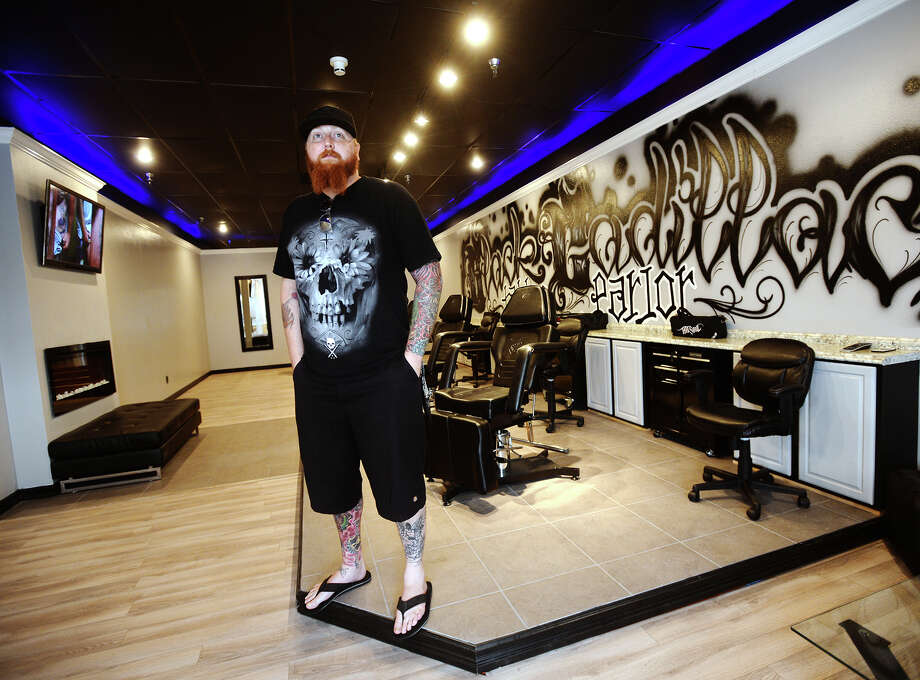 Jacob Smith, owner of Black Cadillac Tattoo Parlor, poses for a picture Saturday afternoon. The shop will open its doors to customers on Tuesday, August 18. Smith designed the shop's layout.