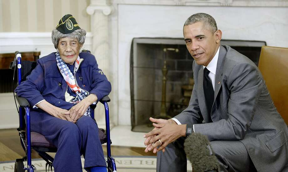 WASHINGTON, DC - JULY 17:  U.S. President Barack Obama meets with the oldest living woman veteran, 110-year-old Emma Didlake in the Oval Office of the White House on July 17, 2015 in Washington, D.C. (Photo by Olivier Douliery-Pool/Getty Images) Photo: Pool, Getty Images