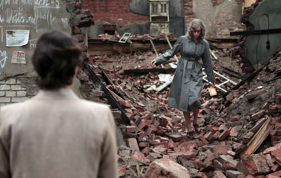 "Concentration camp survivor Nelly, played by Nina Hoss, searches the rubble of postwar Berlin for mementos in ""Phoenix."" Hoss exhibits a conflicting array of emotions in a film that pushes the limits of believability but nonetheless remains engaging. Photo: Sundance Selects"