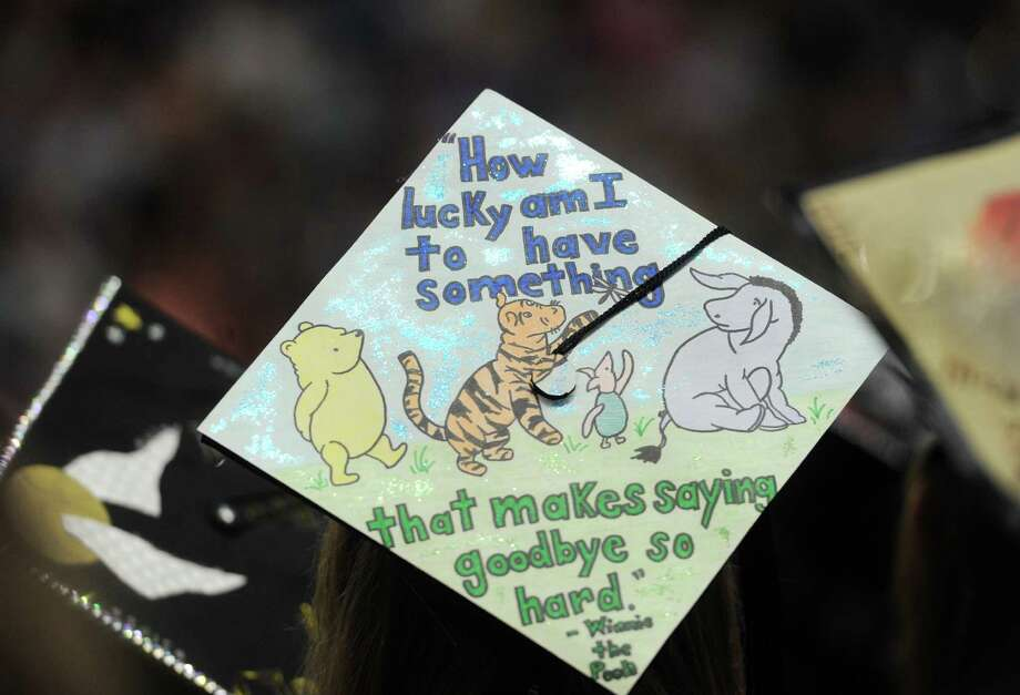 A decorated mortarboard makes a poignant statement at Sacred Heart University Commencement 2015 at the Webster Bank Arena in Bridgeport, Conn. on Sunday, May 17, 2015. Photo: Brian A. Pounds / Hearst Connecticut Media / Connecticut Post