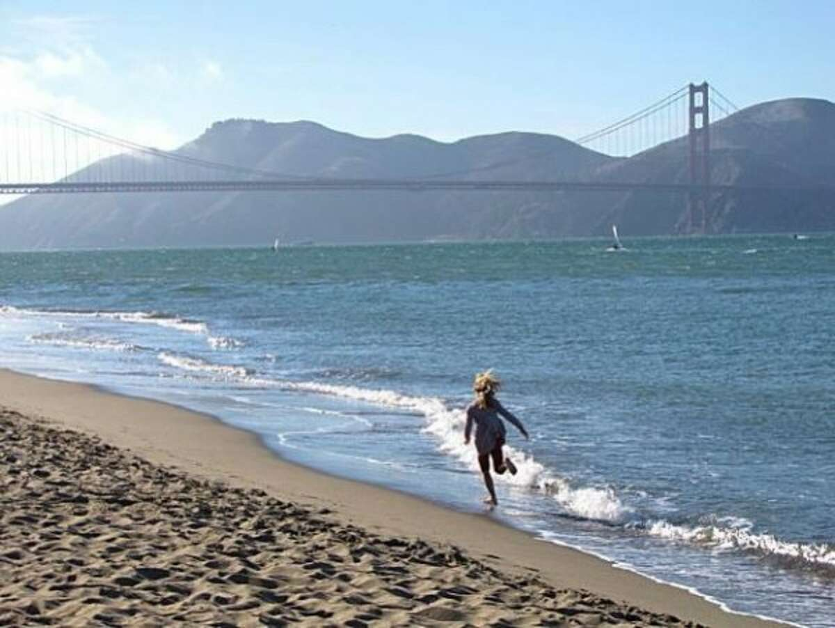 Crissy Field, San Francisco.  On a hot day, you can't beat the beach right next to the Golden Gate Bridge. When the tide is out, pools of water become warm, salty bath tubs. Kids can safely wade and swim, and throw sand. Dogs have a blast here and keep a look out for the designated off-leash areas.