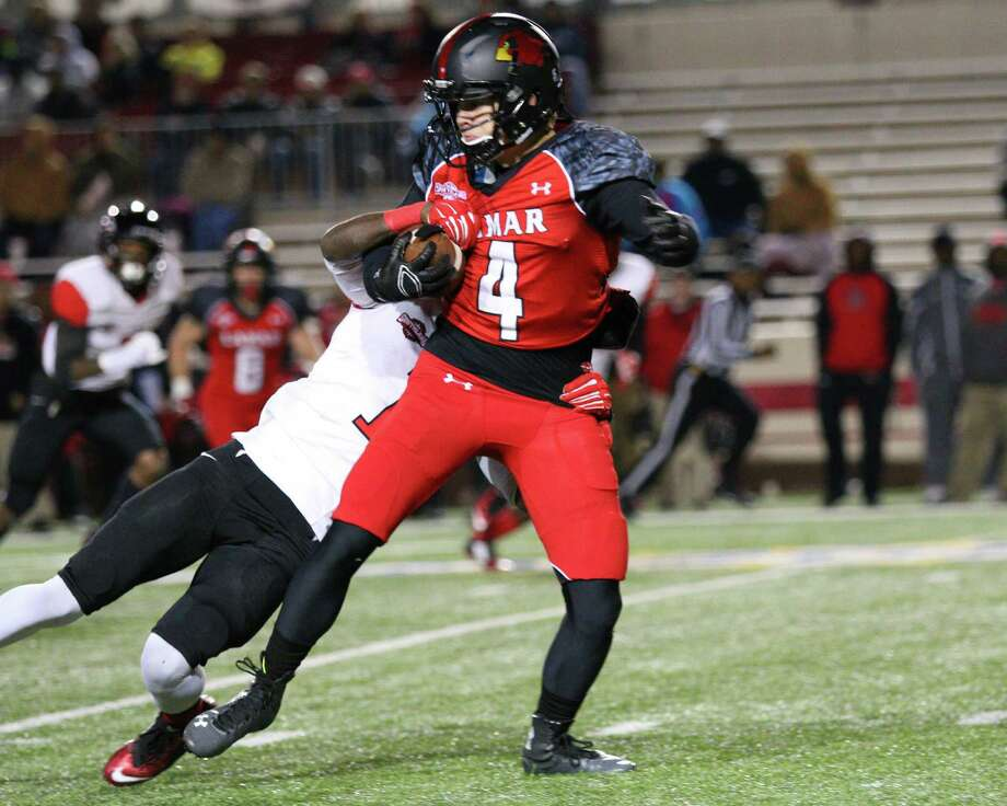 Lamar's Jayce Nelson, 4, spins away from a tackler during the game between the Lamar Cardinals and the Incarnate Word Cardinals at Provost Umphrey Stadium in Beaumont, November 15, 2014 (photo provided by Kyle Ezell).