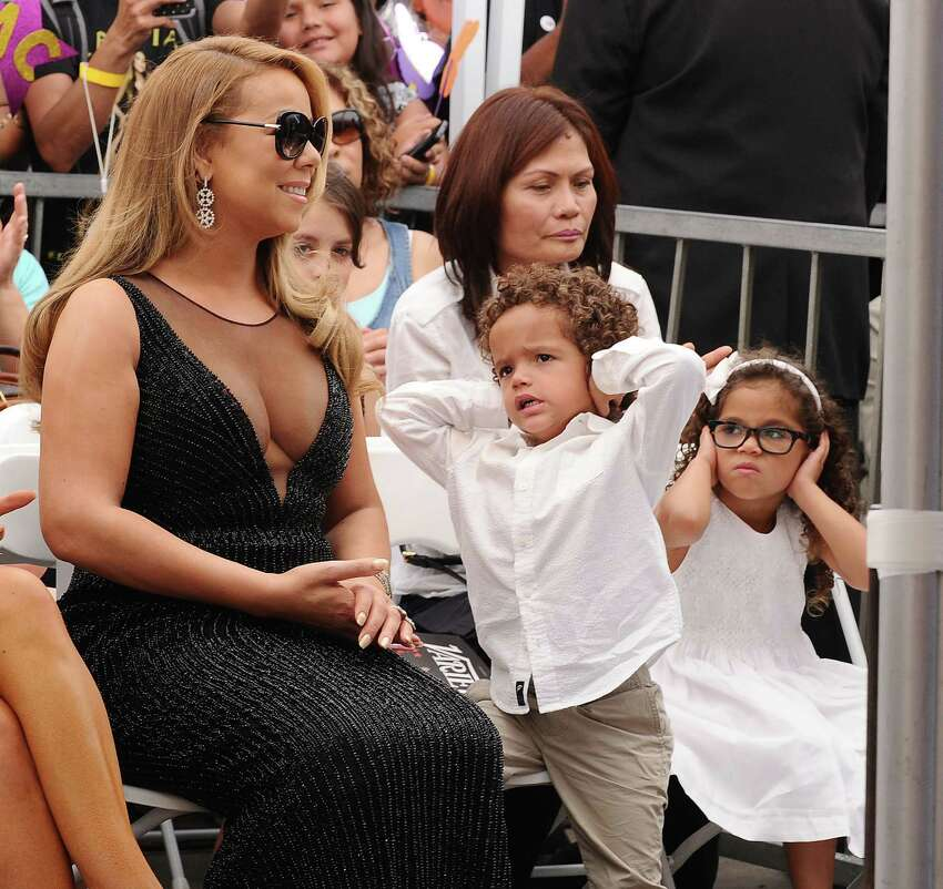 HOLLYWOOD, CA - AUGUST 05: Mariah Carey and children Moroccan Scott Cannon and Monroe Cannon attend Carey's induction into the Hollywood Walk of Fame on August 5, 2015 in Hollywood, California. (Photo by Jason LaVeris/FilmMagic)