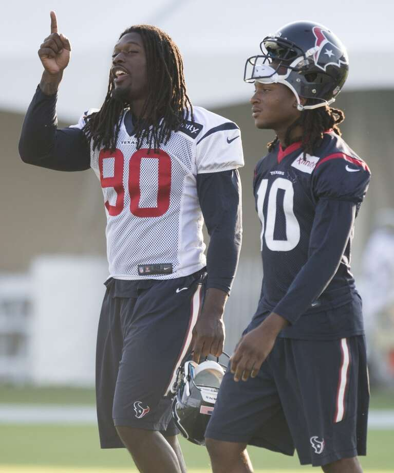 Houston Texans outside linebacker Jadeveon Clowney (90) and wide receiver DeAndre Hopkins (10) walk onto the practice field during Texans training camp at the Methodist Training Center Monday, Aug. 17, 2015, in Houston. Clowney practiced for the first time Monday, since his season-ending micro fracture surgery last season. ( Brett Coomer / Houston Chronicle ) Photo: Houston Chronicle