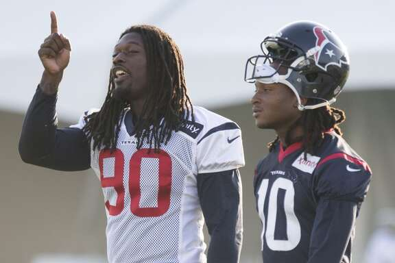 Houston Texans outside linebacker Jadeveon Clowney (90) and wide receiver DeAndre Hopkins (10) walk onto the practice field during Texans training camp at the Methodist Training Center Monday, Aug. 17, 2015, in Houston. Clowney practiced for the first time Monday, since his season-ending micro fracture surgery last season. ( Brett Coomer / Houston Chronicle )