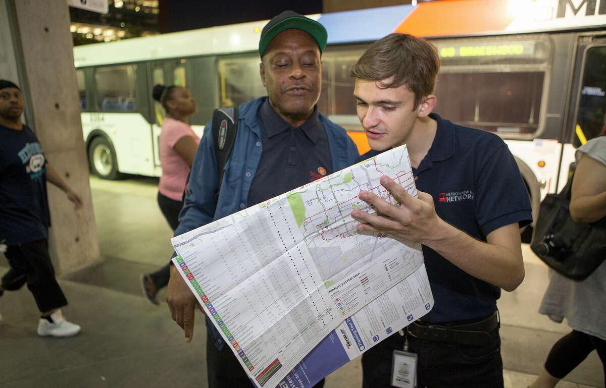 Ochoa assists Carlton Abbott at the Texas Medical Center Transit Center.