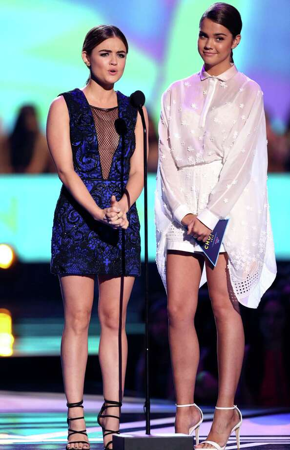 Lucy Hale and Maia Mitchell present the choice male athlete award at the Teen Choice Awards at the Galen Center on Sunday, Aug. 16, 2015, in Los Angeles. (Photo by Matt Sayles/Invision/AP) ORG XMIT: CADA185 Photo: Matt Sayles / Invision