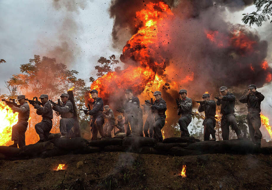 "A large explosion set off by effects technicians goes off as Chinese actors playing Nationalist soldiers are seen during  filming of a battle segment in the series ""Legend of the Stupid Guy"" set during the second Sino-Japanese War on August 11, 2015 in Hengdian, China. Photo: Kevin Frayer, Getty Images / 2015 Getty Images"