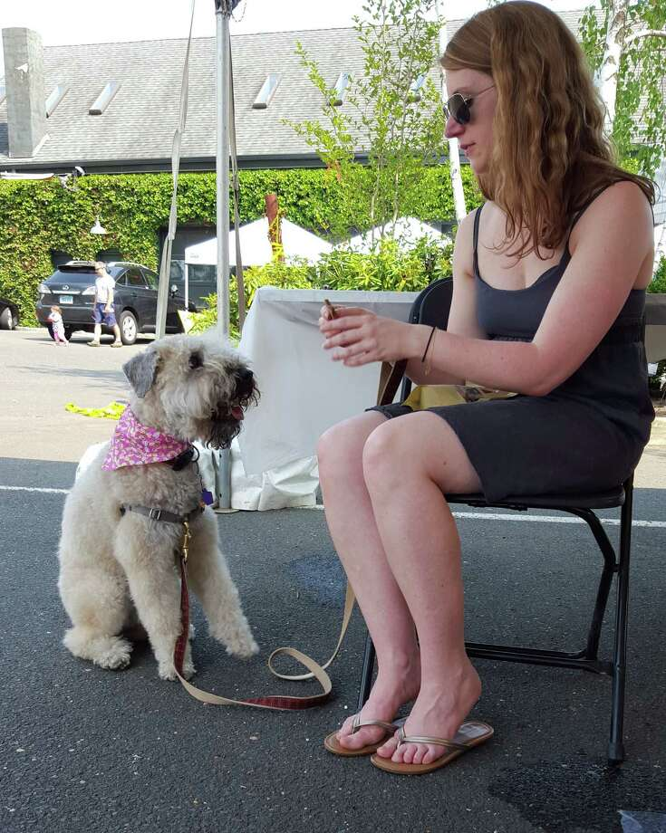 Jessica Calvey with Chloe, for whom Calvey developed a cricket-based, protein dog treat now being sold as Chloe's Treats. Photo: Alexander Soule / Hearst Connecticut Media / Stamford Advocate