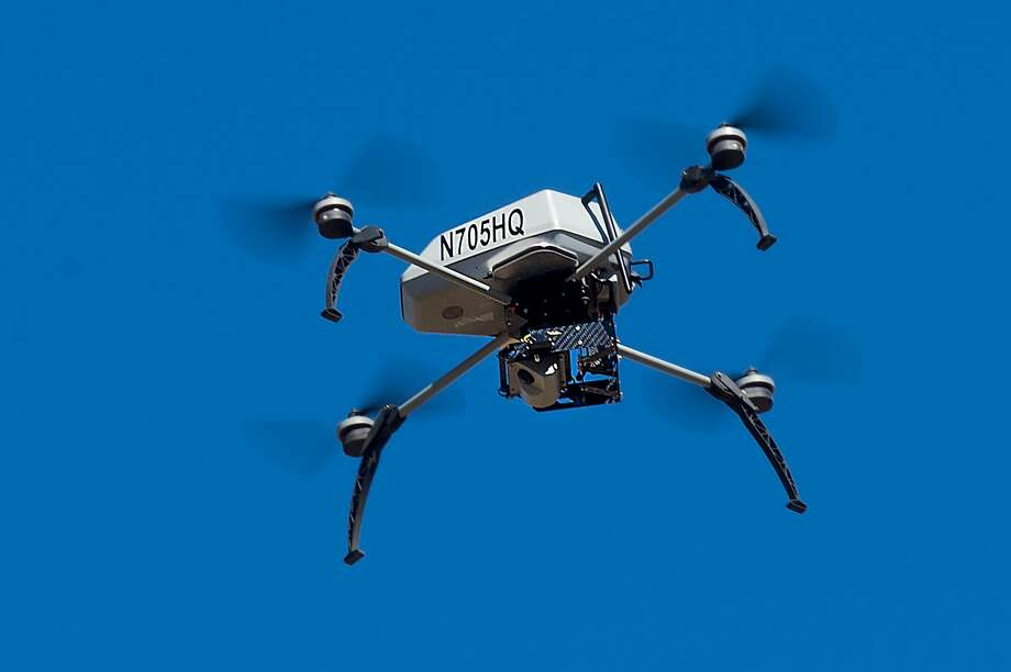 A drone operated by the Alameda County Sheriff's Office flies during a demonstration of a search and rescue operation on Friday, Aug. 14, 2015, in Dublin, Calif. As law enforcement joins the ranks of hobbyists sending drones into California skies, civil liberties advocates are raising the specter of unchecked police surveillance. Photo: Noah Berger, Associated Press