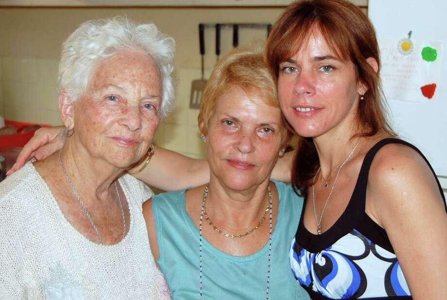 Writer Olivia Tallet (right) with her grandmother María, and her mother, María Lucía, at her mother's home in Havana. Photo: Picasa, Olivia P. Tallet