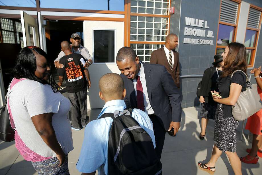 Principal Demetrius Hobson greets students and parents before the first day of school at Willie L. Brown Jr. Middle School in San Francisco, on Monday, Aug. 17, 2015. Hobson abruptly announced his resignation last week after only a few weeks of operation. Photo: Connor Radnovich, The Chronicle