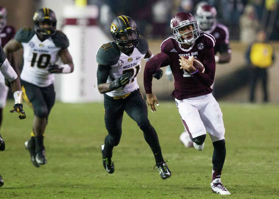 Texas A&M Aggies wide receiver Josh Reynolds breaks away from Missouri Tigers defenders for a catch and touchdown run during the first half of an NCAA football game at Kyle Field, Saturday, Nov. 15, 2014, in College Station. (Cody Duty / Houston Chronicle) Photo: Cody Duty, Staff / © 2014 Houston Chronicle