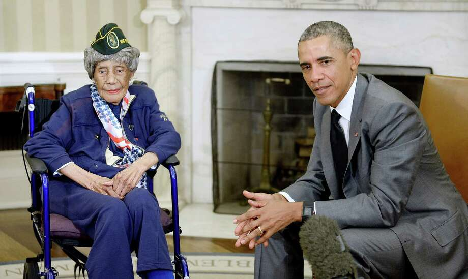 "Emma Didlake, who turned 110 on March 13, met with President Barack Obama in the Oval Office on July 17. She said she joined the Women's Army Auxiliary Corps in 1943 ""to do different things, I wanted to do something different."" Photo: Olivier Douliery /Getty Images / 2015 Getty Images"