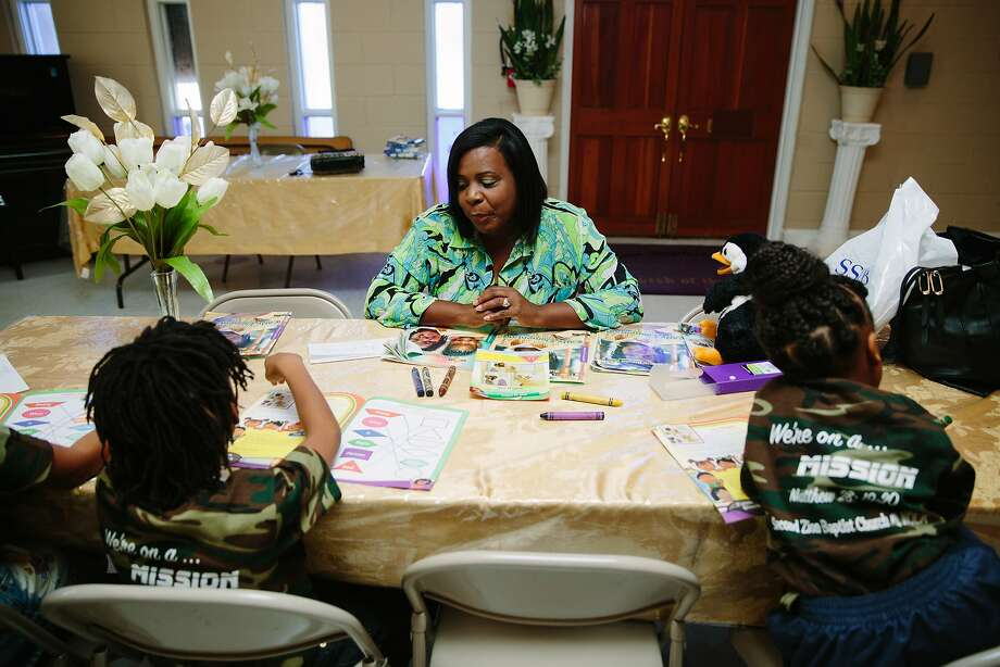 Wanda Davis teaches Sunday School at second Zion Baptist Church in New Orleans on Sunday, August 16, 2015 in New Orleans. Davis and her family were evacuated to the Bay Area after Hurricane Katrina but they have since resettled in New Orleans. Photo: Edmund D. Fountain, Special To The Chronicle