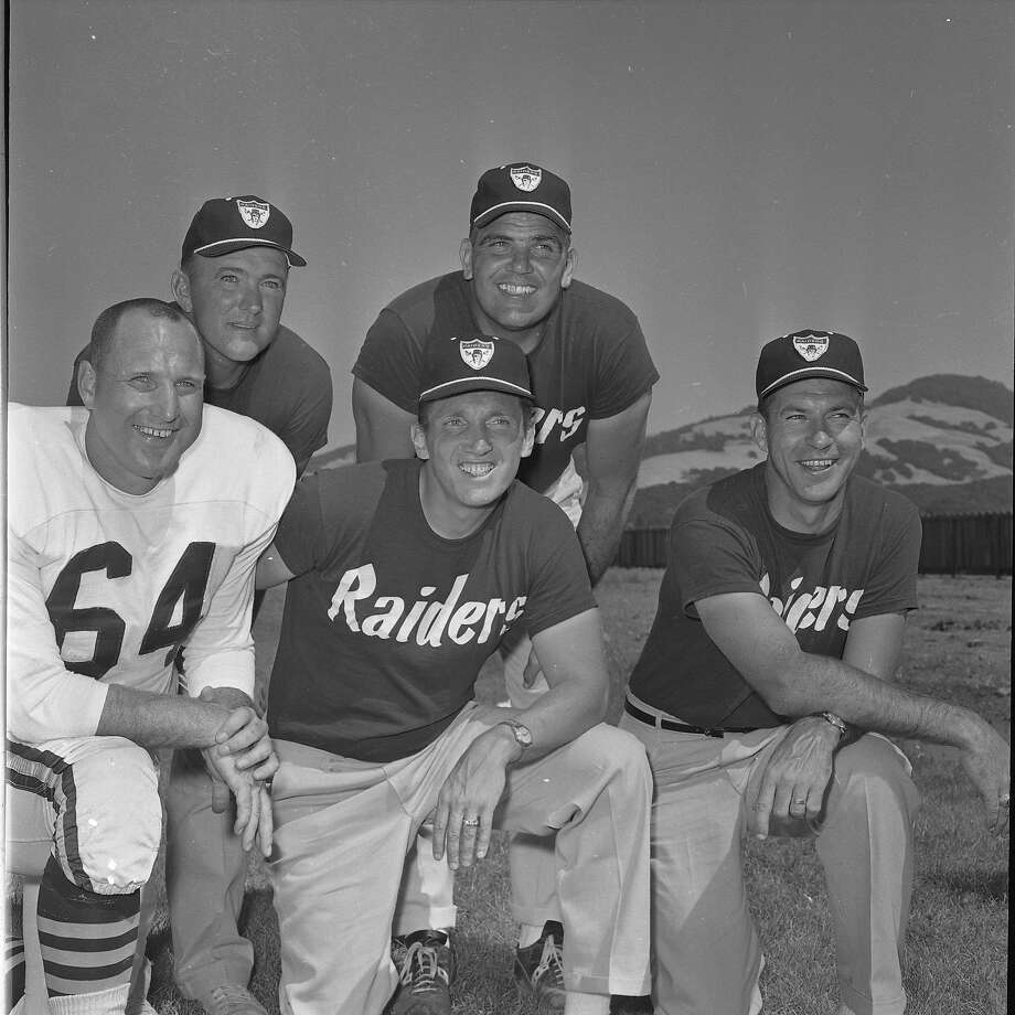 The Oakland Raiders coaching staff in 1963, the year Al Davis (bottom row, center) would take over as head coach.