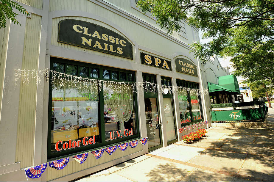 The exterior of Classic Nails can be seen along Hope Street in Stamford, Conn., on Monday, Aug. 17, 2015. The state Department of Labor announced today that about $100,000 in fines were levied upon salons throughout the state, including this salon in Stamford, and orderd them to pay about $47,000 in back wages to some of the salon workers, many of whom were not paid the state's minimum wage. Photo: Jason Rearick / Hearst Connecticut Media / Stamford Advocate