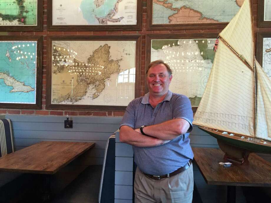 Les Barnes gets ready to open the doors for his Saltaire Oyster Bar and Fish House in Port Chester on Aug. 4. Photo: Evan Fallor / Evan Fallor/Westfair / Westfair/ Greenwich Time Contributed