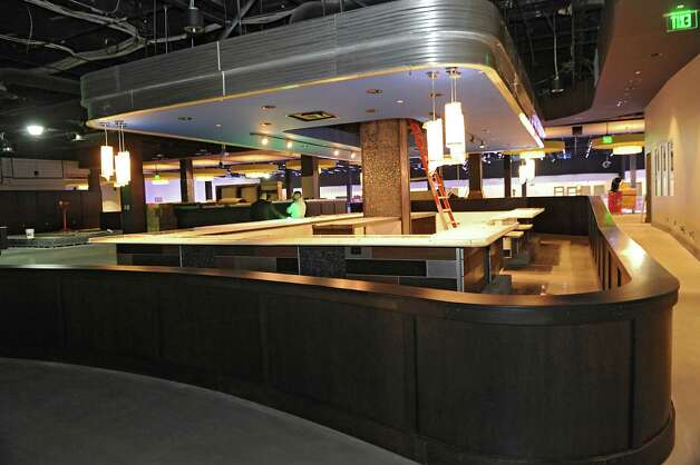 Main bar area at Latitude 360 in Crossgates Mall on Thursday, March 19, 2015 in Guilderland, N.Y. The fiscally troubled luxury bowling alley will not be coming to Crossgates Mall after all.(Lori Van Buren / Times Union archive) Photo: Lori Van Buren / 00031037A