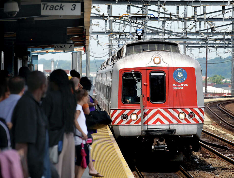 This file photo shows commuters waiting on the platform as a commuter train arrives in Bridgeport, Ct. Could a commuter rail project finally become a reality between San Antonio and Austin? Area residents should hope that it does. Photo: Craig Ruttle /Associated Press / AP2011