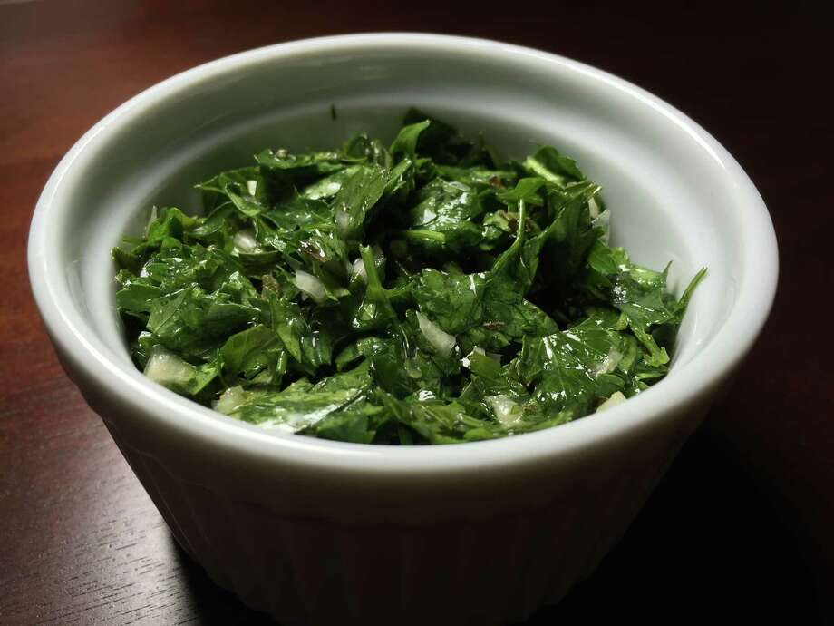 Chimichurri, a mixture of minced parsley, onion, olive oil, vinegar and oregano, is a classic Argentinian accompaniment for grilled meats. Photo: Edmund Tijerina
