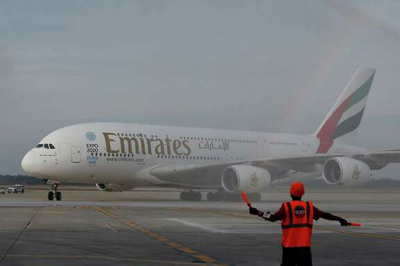 Bush Intercontinental Airport is on track for another record-breaking year in international travelers. Pictured is Emirates' inaugural A380 flight to Bush Intercontinental Airport on Wednesday, Dec. 3, 2014, in Houston, TX.  (Aaron M. Sprecher/AP Images for Emirates)