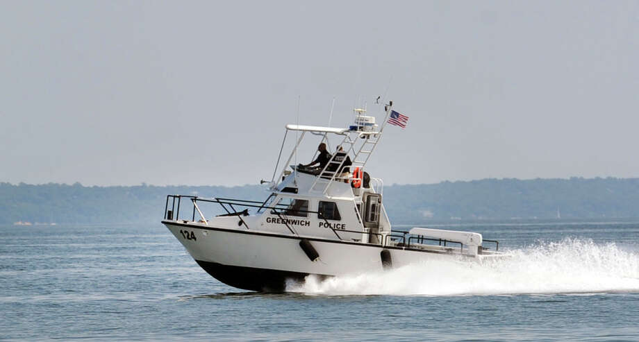 A Greenwich Police boat patrols Long Island Sound off the coast of Greenwich, Conn. File photo. Photo: Bob Luckey / Bob Luckey / Greenwich Time