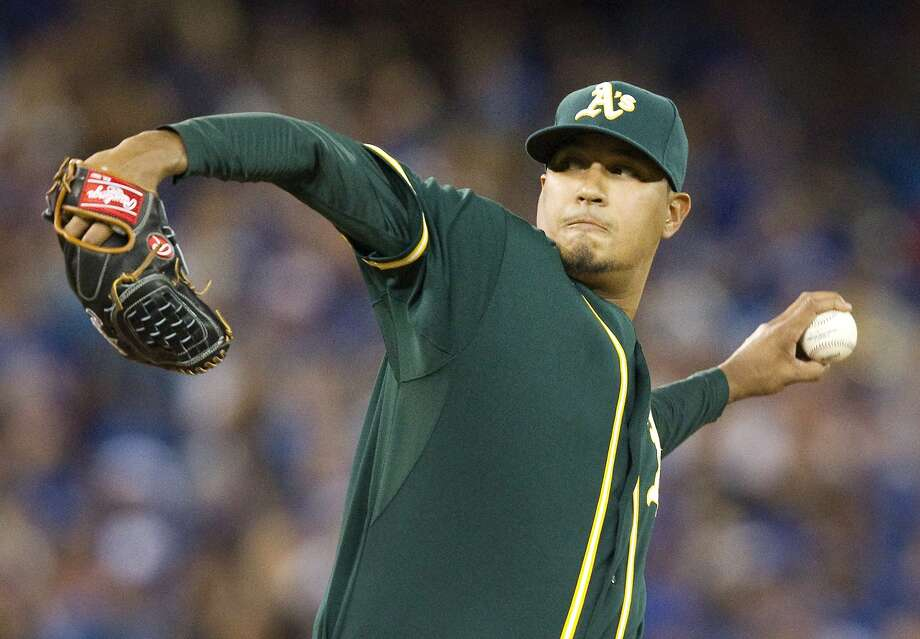 Oakland Athletics pitcher Felix Doubront throws against the Toronto Blue Jays during the fifth inning of a baseball game, Wednesday, Aug. 12, 2015, in Toronto. (Fred Thornhill/The Canadian Press via AP) Photo: Fred Thornhill, Associated Press