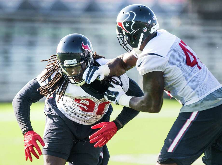 Texans linebackers Jadeveon Clowney (90) and Lynden Trail run a drill during Texans training camp on Aug. 17, 2015. Photo: Brett Coomer, Staff / © 2015 Houston Chronicle