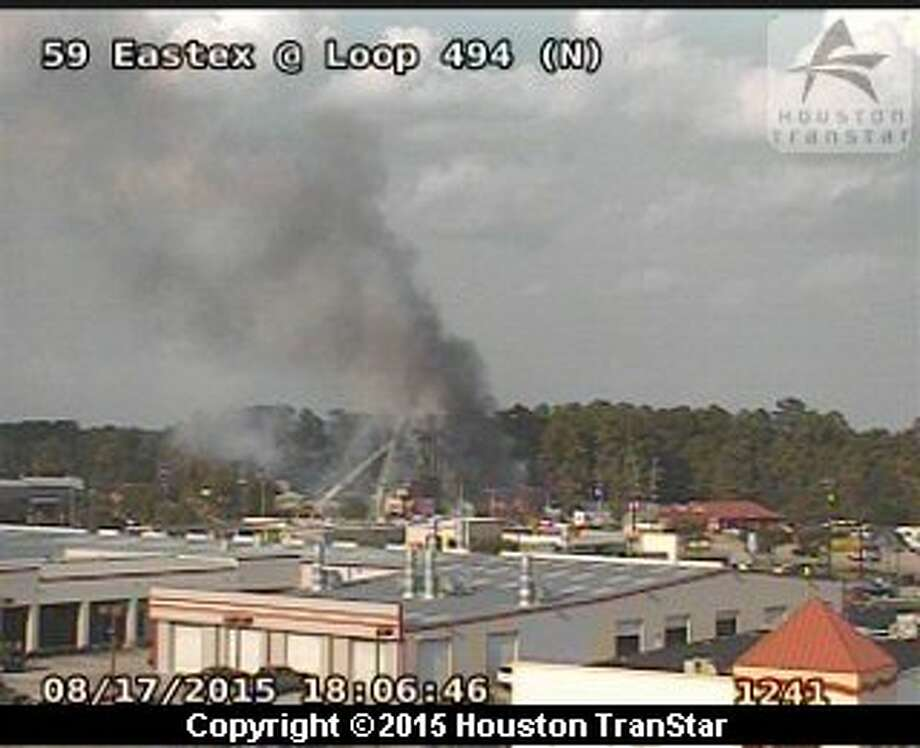TranStar cameras showed smoke rising at the scene of a fire off the Eastex Freeway and Loop 494 on Monday. Photo: TranStar