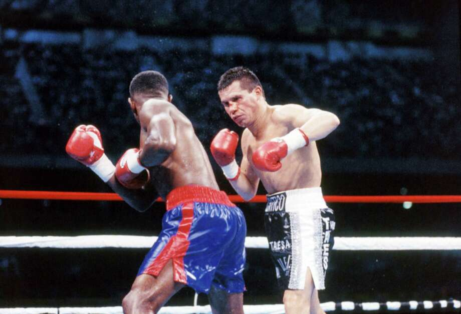 Julio Cesar Chavez (right) throws a punch against Pernell Whitaker during the fight at the Alamodome, on Sept. 10,1993, in San Antonio. Photo: Getty Images / 2012 The Ring Magazine