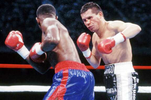 Julio Cesar Chavez (right) throws a punch against Pernell Whitaker during the fight at the Alamodome, on Sept. 10,1993, in San Antonio.