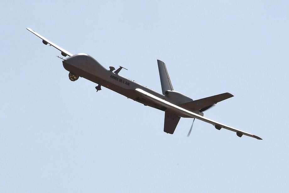 The Reaper drone is part a U.S. arsenal that will expand because of greater security demands. Photo: DOMINIQUE FAGET, Staff / AFP