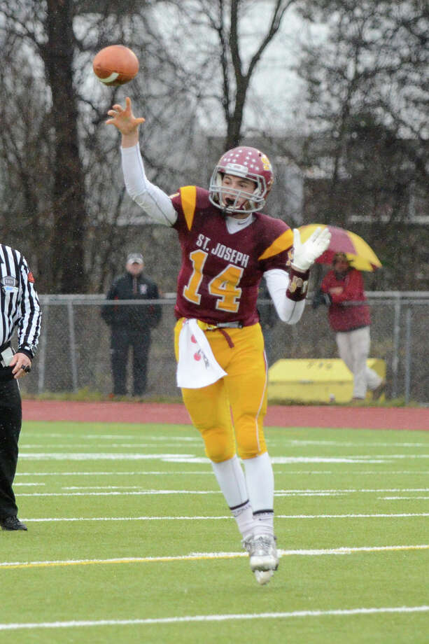 St. Joseph QB Cory Babineau won eight of his nine starts in 2014. Photo: Shelley Cryan / Shelley Cryan / Connectict Post freelance/Shelley Cryan