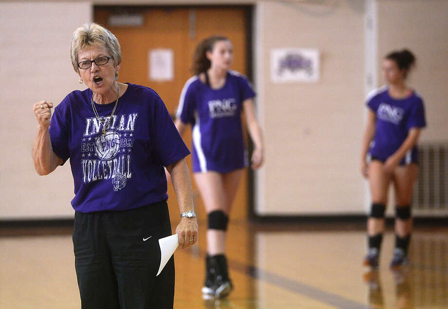 Port - Neches Groves volleyball head coach Barbara Comeaux offers feedback to her players during practice Monday.  Photo taken Monday, August 17, 2015 Kim Brent/The Enterprise Photo: Kim Brent / Beaumont Enterprise