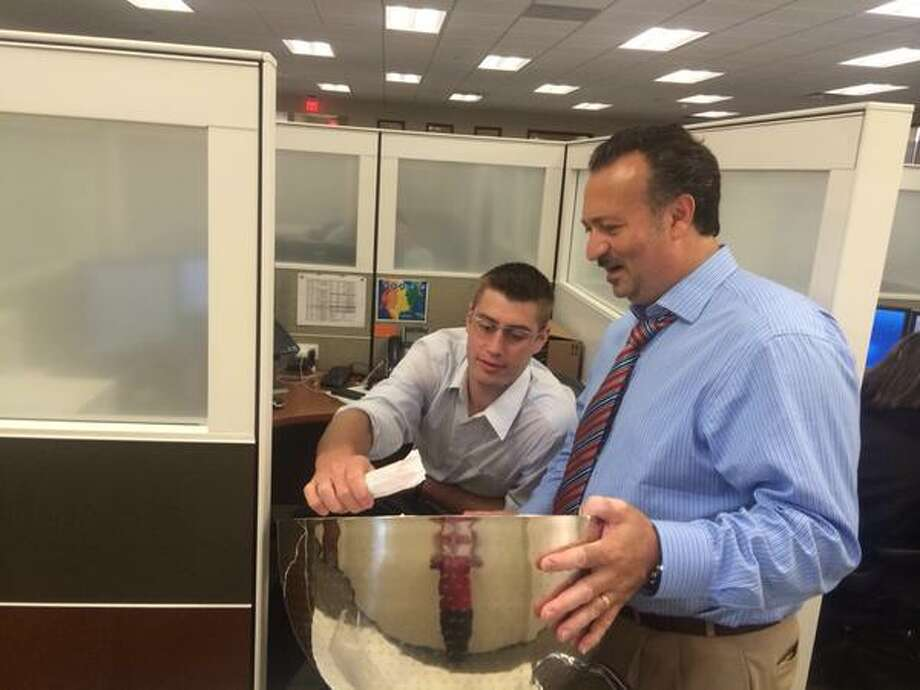 Transfinder CEO Antonio Civitella hands out ice cream last week to employees at the software company's Schenectady headquarters.