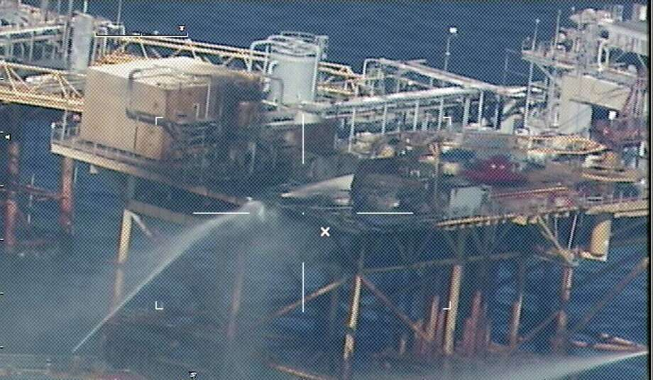 Firefighting ships pour water on an offshore platform operated by Black Elk Energy after a fatal 2012 explosion. The company faces criminal charges. Photo: HO, Handout / AFP