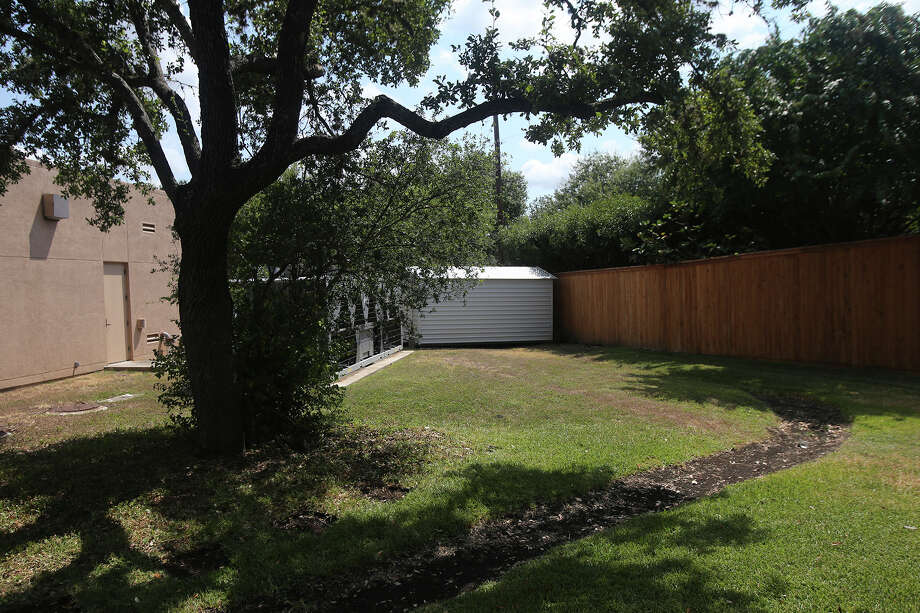 """Grafitti on the side of a shed Monday August 17, 2015 at the back of Cogregation Agudas Achim on the 16,000 block of Huebner appears to read """"Jews Jew."""" The area near Congregation Rodfei Sholom on Northwest Military Highway was recently defaced with racist garfitti. Photo: John Davenport, Staff / San Antonio Express-News / ©San Antonio Express-News/John Davenport"""