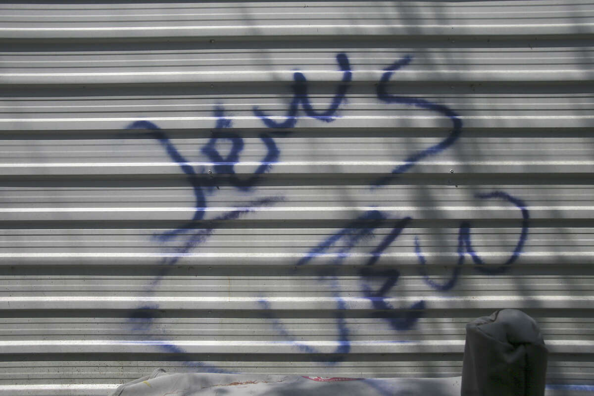 Graffiti marks a shed at Congregation Agudas Achim property in the 16500 block of Huebner Road on the North Side.