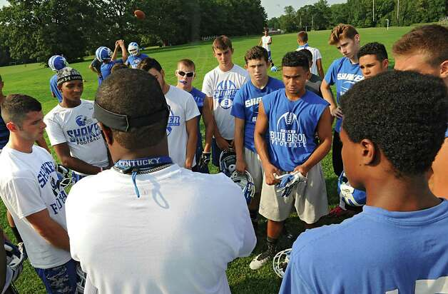 Secondary coach Robbin Williams talks to some of the players as the Shaker football team holds their first practice at Shaker High School on Monday, Aug. 17, 2015 in  Latham, N.Y. (Lori Van Buren / Times Union) Photo: Lori Van Buren / 00033030A