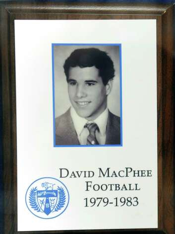 A framed photo of Shaker football player Brendan MacPhee's father David is displayed outside a gym at Shaker High School on Monday, Aug. 17, 2015 in  Latham, N.Y. (Lori Van Buren / Times Union) Photo: Lori Van Buren / 00033030A