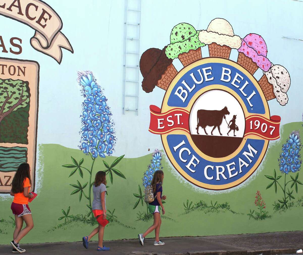 Blue Bell ice cream, which is advertised on a mural in Brenham, was sold in 23 states before the outbreak. It will be distributed again in five phases.
